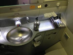 Business class bathroom with amenities